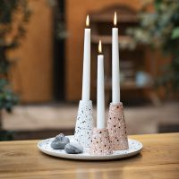 A dish and candlesticks from bamboo fibres decorated with terrazzo flakes