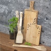 Bamboo kitchen utensils decorated with a pyrography tool