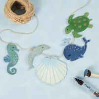 A garland with wooden sea creatures decorated with craft paint