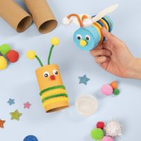 Insects made from cardboard tubes decorated with basic craft materials