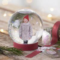 A snow globe with a photo